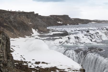 Amazing Icelandic winter landscape of majestic waterfall of frozen Gullfoss 写真素材