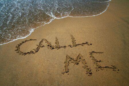 Call me beach writing Stock Photo