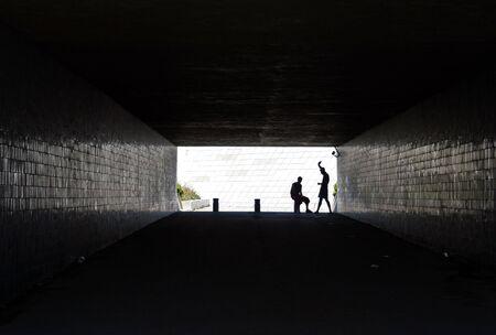 Two men inside tunnel Stock Photo
