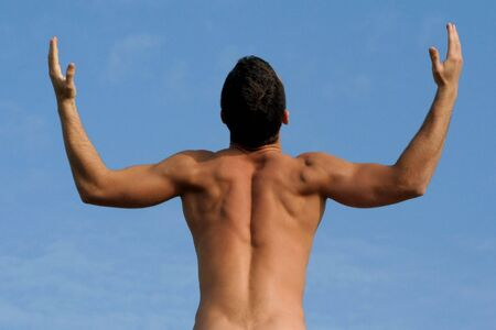 Man with a body builder back xpressing freedom