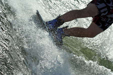 splash - young man wakeboarding