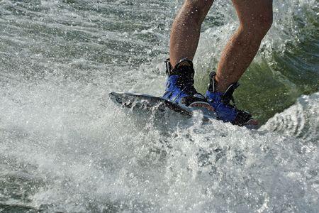 splash - young man wakeboarding photo