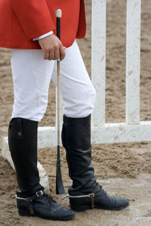 Jockey wearing black leather riding boots
