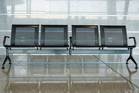 Empty chairs at an airport photo