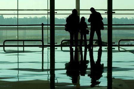 Family waiting at the international airport terminal