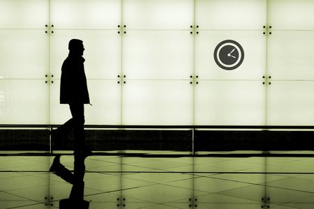 Man walking through an airport terminal Stock Photo