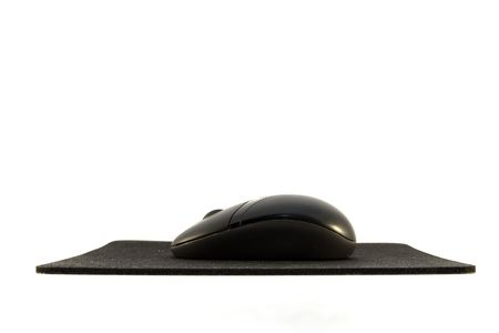 mouse pad: A black computer mouse with mouse pad.
