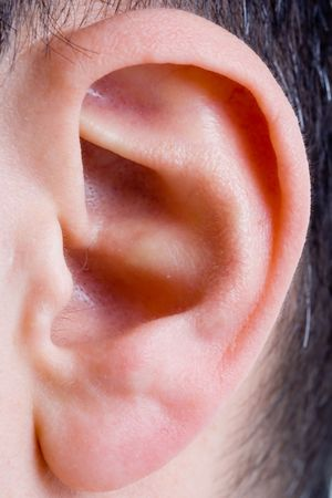 closeup of a man ear in color Stock Photo