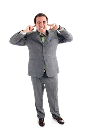 A businessman covering his ears with his fingers Stock Photo - 1483416