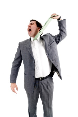 Young bussiness man hanging himself with his tie due to stress photo