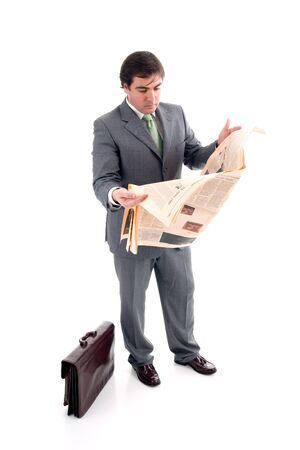 Business man reading business section of newspaper on white background Stock Photo
