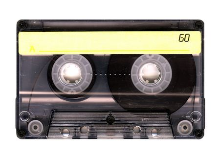 Old Grungy cassette tape isolated over white background