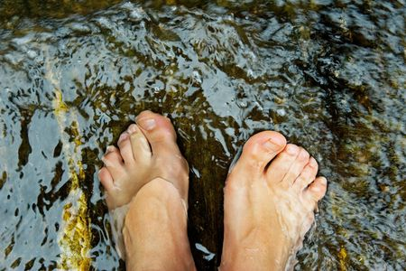 water shoes: Womans feet underwater