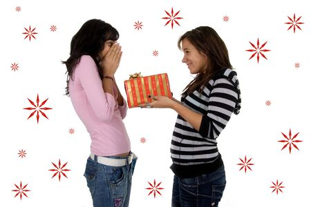 young girl giving a christmas present to her friend Stock Photo