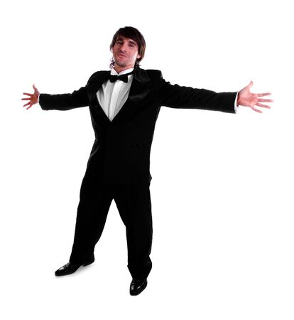 man with his arms open wearing black tuxedo