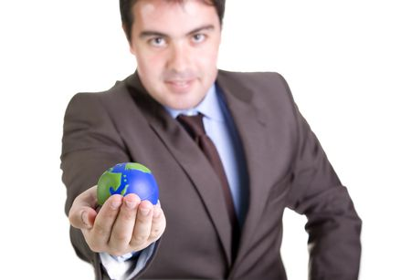 masculin: businessman holding a mini globe - focus on the hand