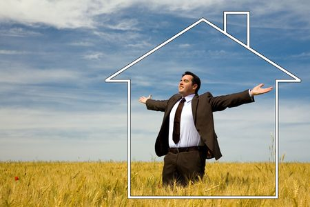 arms wide open: businessman with his arms wide open in rural field with dream house
