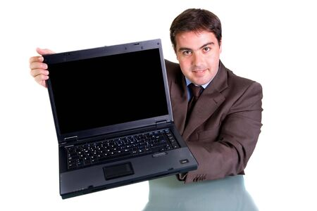 Businessman showing his laptop - focus on the face Stock Photo - 3582966
