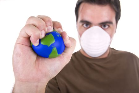 man with protection mask destroy  the earth globe with his hands - nature and ambientalist concept Stock Photo - 3582869