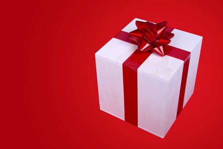 single present box with red ribbon photo