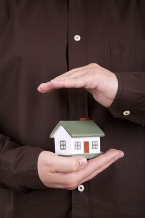 man holding a small house in his hands Stock Photo - 3851404