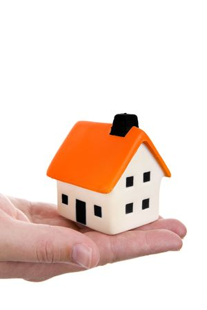 human hand holding a small house Stock Photo