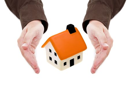 man hands holding small house isolated on white background