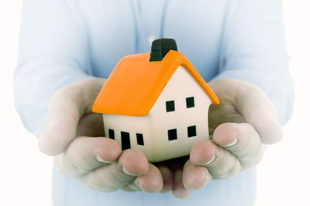 man holding a small house in his hands with dream effect to enphasize the house  Stock Photo