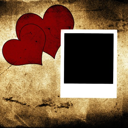 polaroid and two hearts on vintage grunge background photo