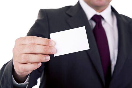 Businessman showing his business card, focus on fingers and card. Stock Photo