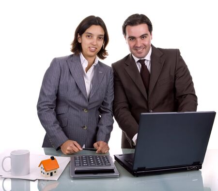 Two friendly business partners working on a laptop computer photo