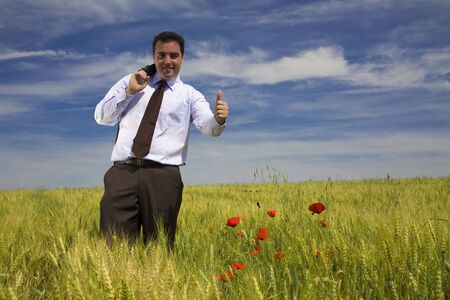 Businessman in a spring field photo