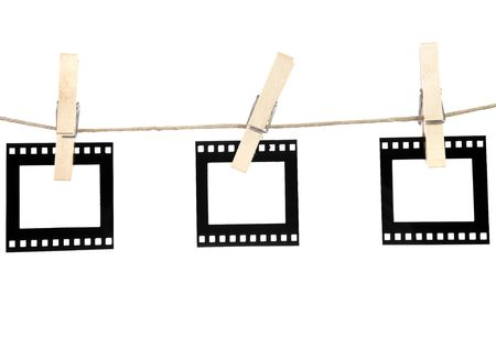 old film blanks hanging on a rope held by clothespins Stock Photo