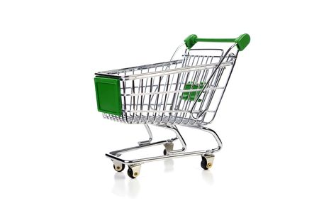 greenshopping cart over white background Stock Photo