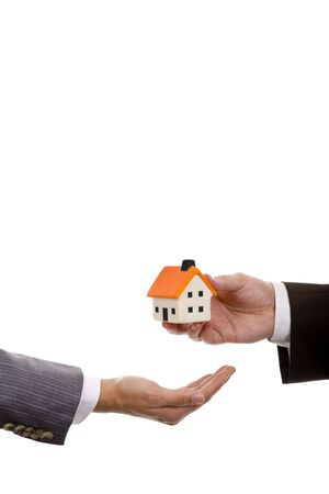 hand holdinh a small house - real state house credit concept Stock Photo - 4797896