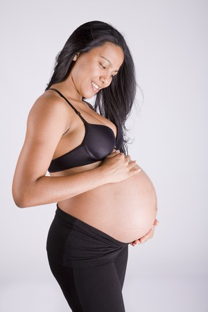 smiling and young beautiful pregnant woman photo