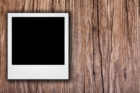 blank photo on grunge wood background