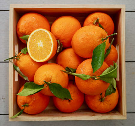box of fresh oranges Фото со стока