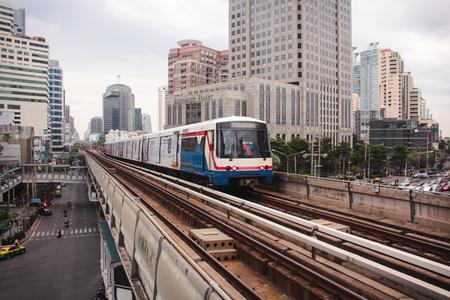 Bangkok, Thailand - November 2017: BTS Skytrain driving to the platform at Asok Station. Bangkok Mass Transit System. Redakční