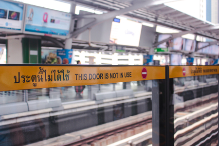 Bangkok, Thailand - November 2017: THIS DOOR IS NOT IN USE sign at BTS Skytrain platform in Asok Station. Editorial