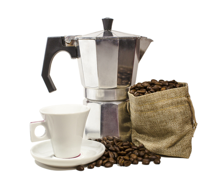 Aluminium moka pota, white ceramic coffee cup and burlap sack overflowing with roasted coffee beans in white background.