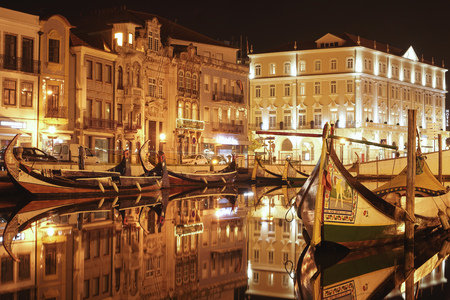 Beautiful Aveiro Water Canals at night, well-lit and illuminated. With water reflections.