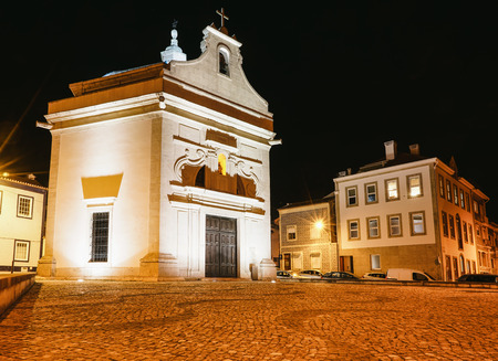 Beautiful view of the Chapel of Sao Goncalinho and surrounding area, late at night and fully illuminated. Stockfoto