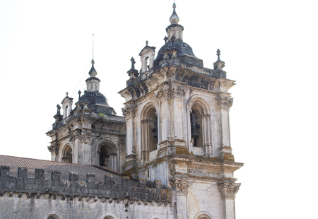 Close up of the baroque towers of Alcobaca Monastery, during bright day. Roman Catholic monastic complex in Portugal.