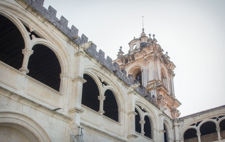 Bottom view from the cloister of the Alcobaca Monastery and the baroque tower.