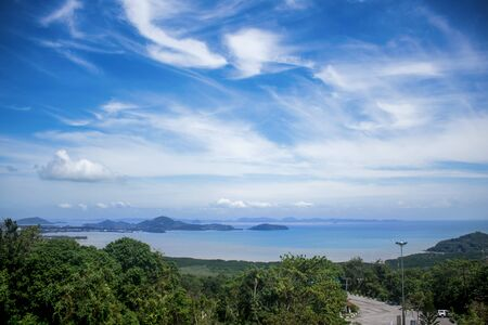 View from Khao-Khad Views Tower looking northeast to Andaman Sea, Ko Sire island, mountains. With interesting blue sky. Stockfoto