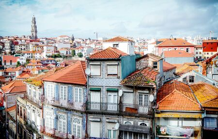 View from Porto Cathedral to typical historic houses of Porto, with tower of Clerigos Church far in the distance.