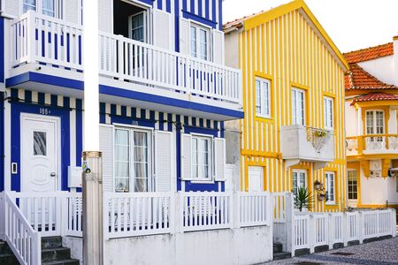 Colorful traditional blue, yellow and white houses, or palheiros, in the famous Costa Nova town, with lovely balconies. 版權商用圖片
