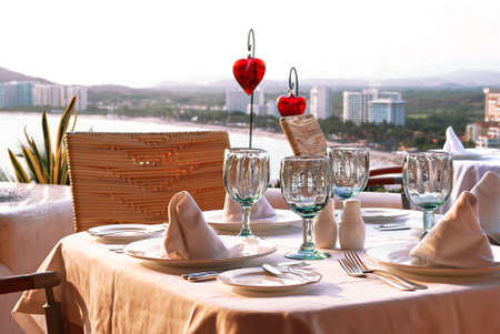 Table set ready for romantic dinner photo