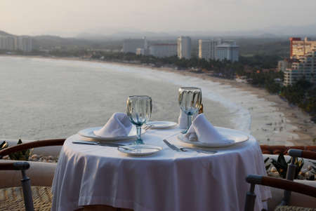 Dinner table for two with panoramic beach view